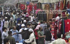 People crowd the shops selling warm clothes on the footpath outside Baitul Mukarram Market in Dhaka on Friday, Dec 11, 2020 as the demand rises along with cold with winter days away.