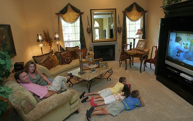 Todd and Lisanne Trcka, with their three children in suburban San Antonio, Texas, watching TV, June 29, 2006. The New York Times