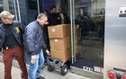 Boxes of potential evidence are removed by officers during a raid of the corporate headquarters for Nygard International in New York, Feb. 25, 2020. Peter Nygard, the Canadian fashion retailer, has been indicted on charges of sex-trafficking, racketeering and other crimes involving dozens of women, some of them underage, federal prosecutors in Manhattan said on Tuesday, Dec. 15, 2020. Nygard's lawyer in New York, Elkan Abramowitz, declined to comment on the charges. (Earl Wilson/The New York Times)
