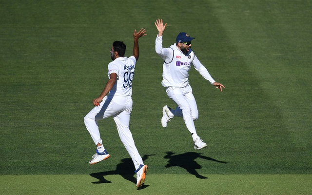 Indian captain Virat Kohli reacts with bowler Ravichandran Ashwin (L) on day 2 of the first test match between Australia and India at Adelaide Oval, Adelaide, Australia, December 18, 2020. AAP Image/Dave Hunt via REUTERS