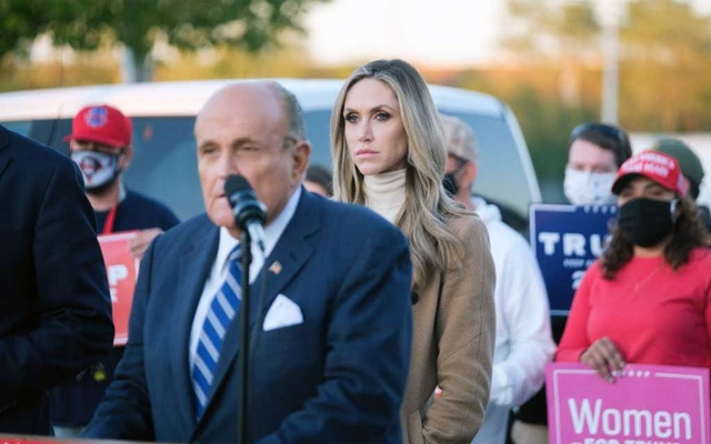 Lara Trump, President Donald Trump's daughter-in-law, looks on as Rudy Giuliani, the president's attorney, speaks at a news conference in Philadelphia on Nov. 4 2020. She served as a senior campaign adviser and surrogate to Trump. (Gabriela Bhaskar/The New York Times)