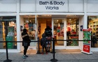 Shoppers wait in line outside a Bath and Body Works retail store, as the global outbreak of the coronavirus disease (COVID-19) continues, in Brooklyn, New York, US, December 8, 2020. REUTERS