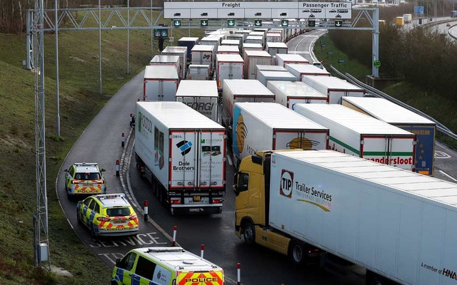 Freight vehicles line up prior to boarding a train to France via the Channel Tunnel, amid the coronavirus disease (COVID-19) outbreak, in Folkestone, Britain, December 20, 2020. REUTERS