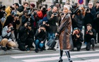 Street-style photographers during Paris Fashion Week 2018. Influencers and street-style photographers changed the fashion ecosystem, creating an entirely new way of selling fantasy — then came a pandemic. (Acielle Tanbetova/The New York Times)