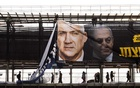 FILE -- Workers install an election billboard featuring Israeli Prime Minister Benjamin Netanyahu and his opponent, Benny Gantz, in Ramat Gan, Israel, Feb 17, 2020. (Dan Balilty/The New York Times)