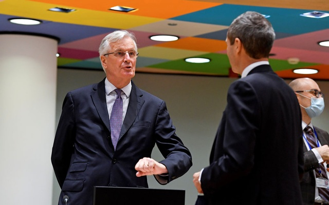 European Union's chief Brexit negotiator Michel Barnier gestures as he speaks with Ambassador Michael Clauss, Permanent Representative of Germany to the EU, during a meeting of the Committee of the Permanent Representatives of the Governments of the Member States to the European Union (COREPER) in Brussels, Belgium December 22, 2020. John Thys/Pool via REUTERS