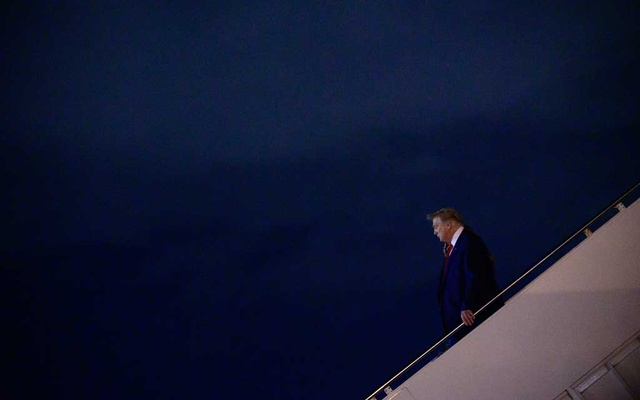 President Donald Trump and first lady Melania Trump depart Air Force One after arriving in West Palm Beach, Fla, Dec 23, 2020. Trump's grants of clemency to convicted liars, corrupt congressmen and child-killing war criminals are a way to lash out at a system that he believes has treated him and his friends unfairly. Erin Scott/The New York Times