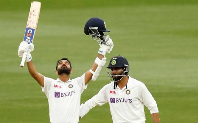 India's Ajinkya Rahane celebrates after reaching his century as his teammate Ravindra Jadeja looks on during day two of the second Test match between Australia and India at The MCG, Melbourne, Australia, December 27, 2020. REUTERS