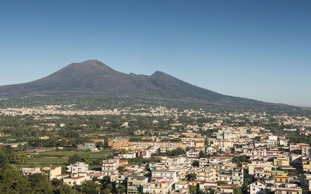 Mount Vesuvius overlooks the town of Pompeii, Italy on Oct. 9, 2019. Archaeologists recently found food and drink residue that is expected to provide fresh clues about the ancient population's culinary tastes. (Susan Wright/The New York Times)