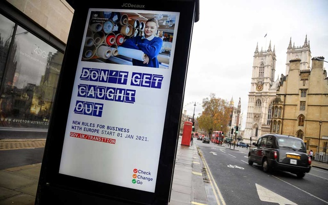 An electronic billboard displays a British government information message advising business to prepare for the Brexit, in London, Britain December 4, 2020. REUTERS