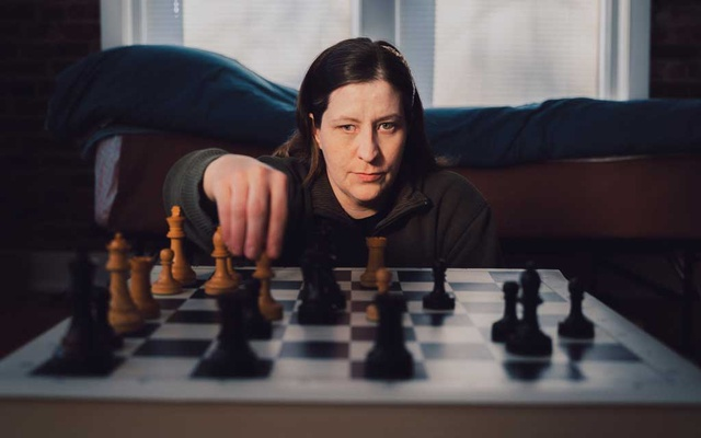 Jessica Lauser, a three-time United States blind chess champion, in her Kansas City, Mo, apartment on Dec 18, 2020. The New York Times