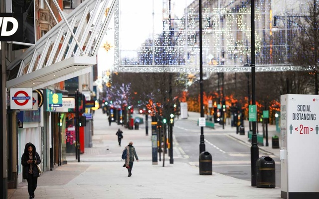 People walk along Oxford Street as shops remain closed under Tier 4 restrictions, amid the coronavirus disease (COVID-19) outbreak, in London, Britain, December 26, 2020. REUTERS