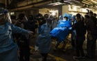 Paramedics transporting the first person to test positive for the coronavirus in Hong Kong on Jan. 22, 2020. Chinese scientists and private laboratories identified the coronavirus and mapped its genes weeks before Beijing acknowledged the severity of the problem. (Lam Yik Fei/The New York Times)