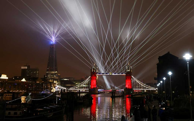 A light show is seen over Tower Bridge in the new year amid the coronavirus outbreak, in London, Jan 1, 2021. REUTERS