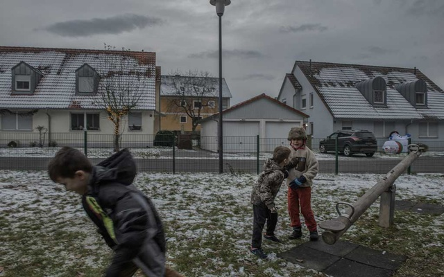 Children on a playground at an off-post village community for American soldiers and their families near Vilseck, Germany, Dec 5, 2020. Laetitia Vancon/The New York Times