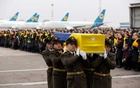 FILE PHOTO: Soldiers carry a coffin containing the remains of one of the eleven Ukrainian victims of the Ukraine International Airlines flight 752 plane disaster during a memorial ceremony at the Boryspil International Airport, outside Kiev, Ukraine January 19, 2020. Ukrainian Presidential Press Service/Handout via REUTERS