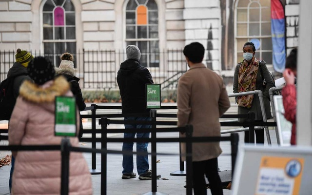 People queue as they wait to receive a COVID-19 vaccine at London Bridge vaccination centre, amidst the spread of the coronavirus disease (COVID-19), in London, Britain December 30, 2020. REUTERS