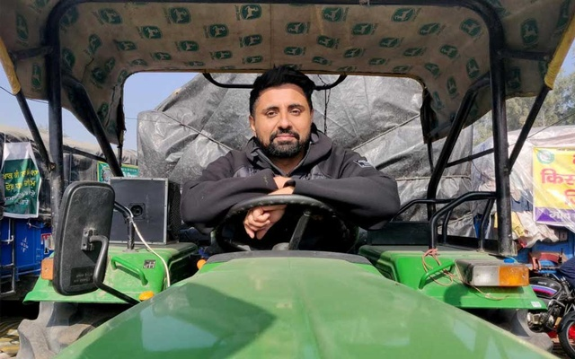 Bhavjit Singh, 38, a computer professional, poses on a tractor at the site of a protest against new farm laws at Singhu border near Delhi, India, December 14, 2020. Picture taken December 14, 2020. REUTERS/Devjyot Ghoshal