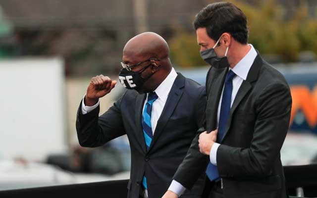 Georgia Democratic US Senate candidates Rev. Raphael Warnock and Jon Ossoff appear side by side ahead of their January 5 runoff elections, at a drive-in campaign rally at Pullman Yard in Atlanta, Georgia, US, December 15, 2020. REUTERS