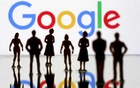 Small toy figures are seen in front of Google logo in this illustration picture, April 8, 2019. REUTERS/Dado Ruvic