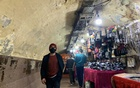 A man wearing a protective face mask walks in a tunnel besides street vendors in Shubra El Kheima, Al Qalyubia Governorate, north of Cairo, amid the coronavirus disease (COVID-19) outbreak, Egypt Jan 5, 2021. REUTERS
