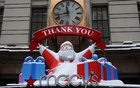 A Santa sits on top of the entrance way to Macy's department store in the Manhattan borough of New York City, New York, US, December 18, 2020. REUTERS