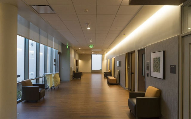 A wide hallway at the Taube Pavilion, a new mental health facility at El Camino Hospital in Mountain View, Calif, Dec 30, 2020. New research into the effects of our surroundings is spurring the development of mental health facilities that feel more residential, like this $98 million project with private rooms, airy spaces and views of greenery. (James Tensuan/The New York Times)