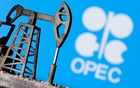 A 3D printed oil pump jack is seen in front of displayed OPEC logo in this illustration picture, April 14, 2020. REUTERS