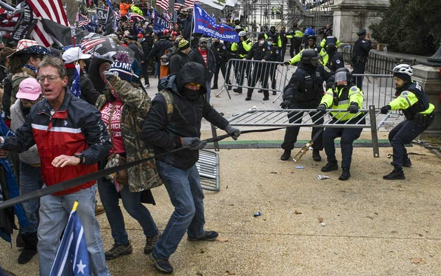 Members of a pro-Trumb mob clash with police at the Capitol in Washington, Wednesday, Jan 6, 2021. The New York Times