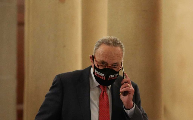 US Senate Minority Leader Chuck Schumer (D-NY) speaks on a cell phone before attending a meeting on Capitol Hill in Washington, US, December 15, 2020. Reuters