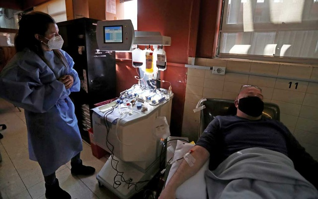 A patient recovered from COVID-19 donated plasma at the Hemotherapy Institute in La Plata, Argentina, in October. Agustin Marcarian/Reuters