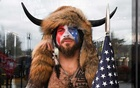 A man with his face painted in the colours of the U.S. flag poses for a picture as supporters of U.S. President Donald Trump gather (not pictured) in Washington, Jan 6, 2021. REUTERS