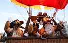 The Three Kings wave as they celebrate the eve of the Epiphany before flying over the city in a hot air balloon as coronavirus disease (COVID-19) restrictions prevent the traditional parade in Seville, Spain, January 5, 2021. REUTERS
