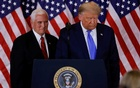 US President Donald Trump and Vice President Mike Pence stand while making remarks about early results from the 2020 US presidential election in the East Room of the White House in Washington, US, November 4, 2020. REUTERS