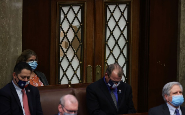 A broken window is seen during a joint session of Congress after they reconvened to certify the Electoral College votes of the 2020 presidential election in the House chamber in Washington, US January 6, 2021. Reuters
