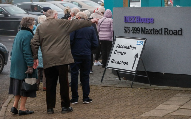 People queue outside a vaccination centre for the coronavirus disease (COVID-19), outside IMEX House in Hemel Hempstead, Britain, January 8, 2021. Reuters