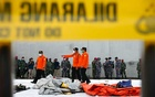 Indonesian rescue members look at what is believed to be the remains of the Sriwijaya Air plane flight SJ182, which crashed into the sea, at Jakarta International Container Terminal port in Jakarta, Indonesia, Jan 10, 2021. REUTERS