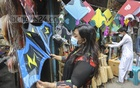 Customers checking kites at a shop in Old Dhaka's Shankharibazar ahead o the Shakrain festival. Photo: Asif Mahmud Ove