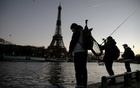Fishermen cast their lines in the Seine, across from the Eiffel Tower, in Paris, Dec 17, 2020. The New York Times