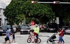 Children head home after school in Miami Beach, Fla., on Monday, Nov. 30, 2020. (Scott McIntyre/The New York Times)