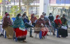 A few suspected coronavirus patients wait at the reception of Mugda Medical College Hospital in Dhaka on Wednesday morning, Jan 13, 2021 as the hospital experiences a decline in the number of sample collection. Photo: Mahmud Zaman Ovi