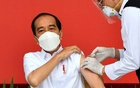 Indonesian President Joko Widodo receives a shot of the coronavirus disease (COVID-19) vaccine at the Merdeka Palace in Jakarta, Indonesia, Jan 13, 2021. REUTERS