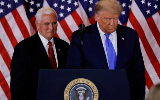 FILE PHOTO: US President Donald Trump and Vice President Mike Pence stand while making remarks about early results from the 2020 US presidential election in the East Room of the White House in Washington, US, November 4, 2020. REUTERS/Carlos Barria/File Photo