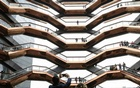 People tour the inside 'The Vessel,' a large public art sculpture made up of 155 flights of stairs, during the grand opening of the The Hudson Yards development, a residential, commercial, and retail space on Manhattan's West side in New York City, New York, US, Mar 15, 2019. REUTERS/FILE