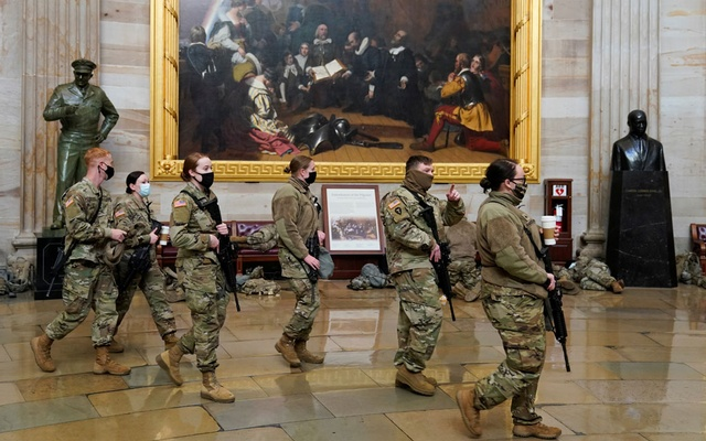 National Guard members walk through the US Capitol, before Democrats begin debating one article of impeachment against US President Donald Trump, in Washington, US, January 13, 2021. Reuters