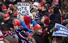Supporters hold up signs as President Donald Trump speaks during a rally in Washington on Wednesday, Jan 6, 2021, protesting the presidential election results. The New York Times