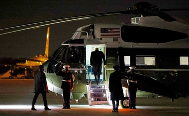 US President Donald Trump boards Marine One at Joint Base Andrews in Maryland to return to the White House, after visiting the US-Mexico border wall in Harlingen, Texas, US, January 12, 2021. REUTERS