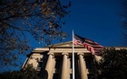 An American flag waves outside the US Department of Justice Building in Washington, US, December 15, 2020. REUTERS