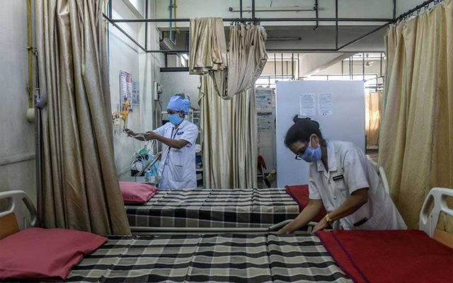 Nurses prepare a vaccine center in Pune, India, on Friday, Jan. 15, 2021, ahead of Saturday's COVID-19 vaccine inoculations. India on Friday was preparing to launch one of the most ambitious and complex nationwide campaigns in its history: the rollout of coronavirus vaccines to 1.3 billion people, an undertaking that will stretch from the perilous reaches of the Himalayas to the dense jungles of the country's southern tip. (Atul Loke/The New York Times)