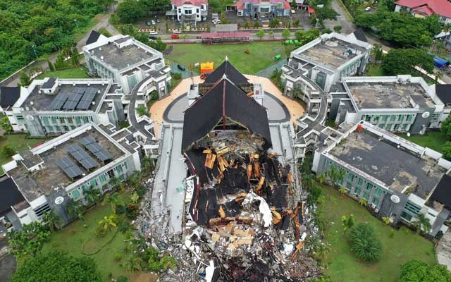An aerial picture shows damaged governor of West Sulawesi province's office following an earthquake in Mamuju, West Sulawesi, Indonesia, January 16, 2021 in this photo taken by Antara Foto. Antara Foto/Sigid Kurniawan/ via Reuters